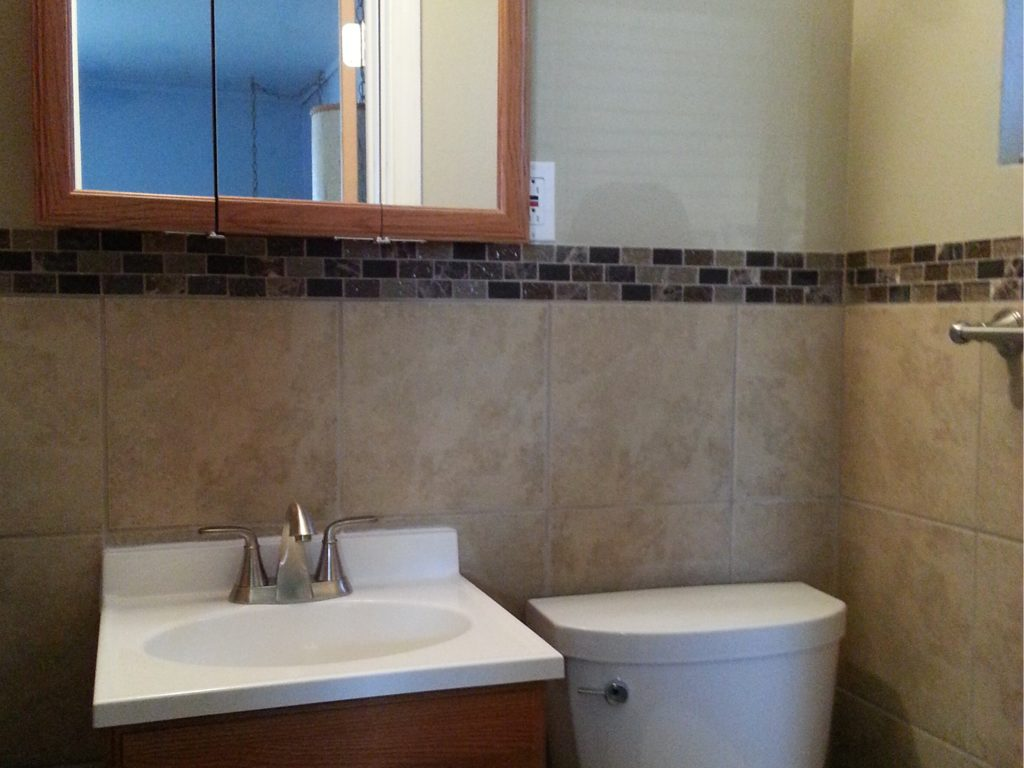 Small bathroom remodel jmj remodeling experts for Small bath renovation pictures