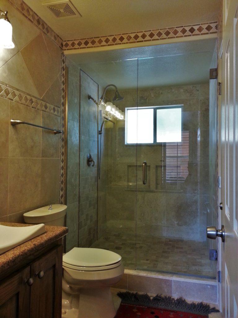 Travertine tile bathroom remodel jmj remodeling experts for Redo bathroom tile