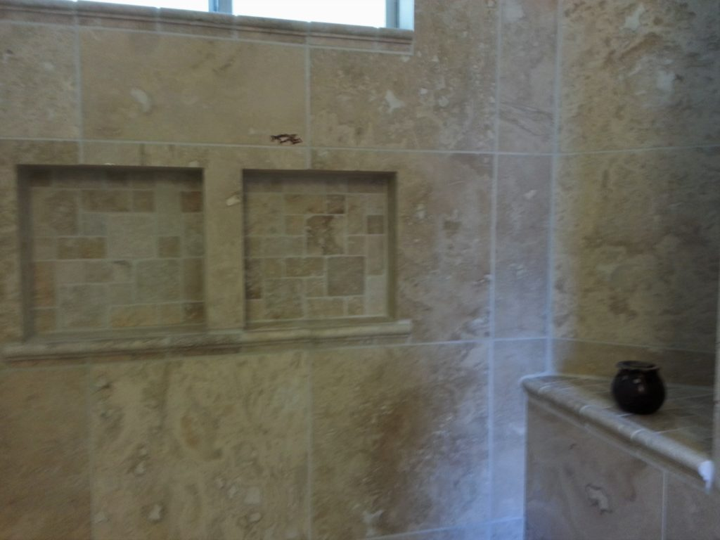 Travertine tile bathroom remodel jmj remodeling experts for Travertine tile bathroom gallery