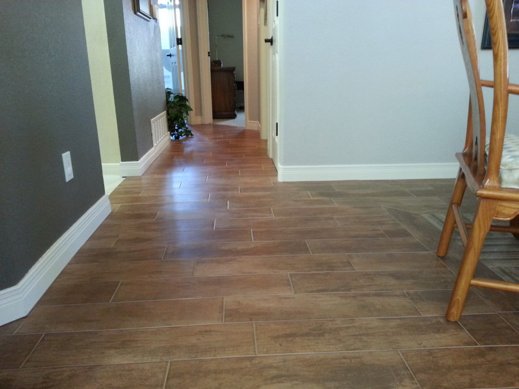 Wood style tile floor jmj remodeling experts for Tile styles 2016